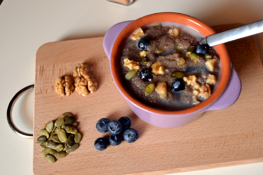 Blueberry Amaranth Porridge with Walnuts & Pumpkin Seeds, served with ...